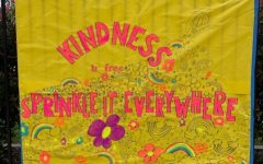 A Kindness Week poster in the front of campus.