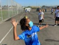 Layla Whitehead, 6th grader, serving a volleyball.