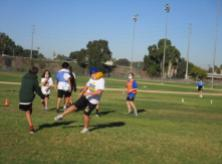 Students playing soccer in PE.